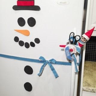 Snowman Fridge (an easy Elf on the Shelf idea)