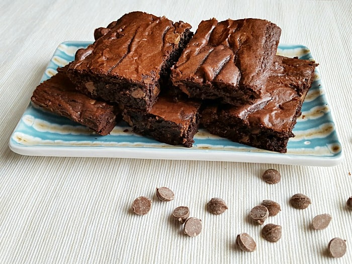 These delightful fudgy brownie bars do not have a light cake-like consistency. These are thick, dense and rich brownies with a fudgy center.
