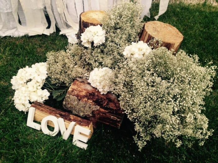 Logs used for bridal shower decor