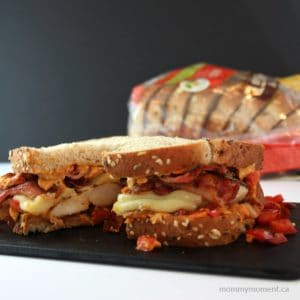 RUSTIC CHICKEN AND BACON SANDWICH WITH ROASTED RED PEPPER HUMMUS AND ONIONS