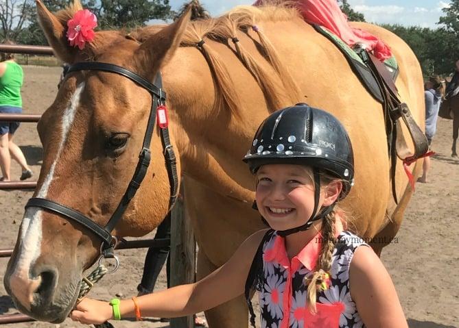 child leading horse