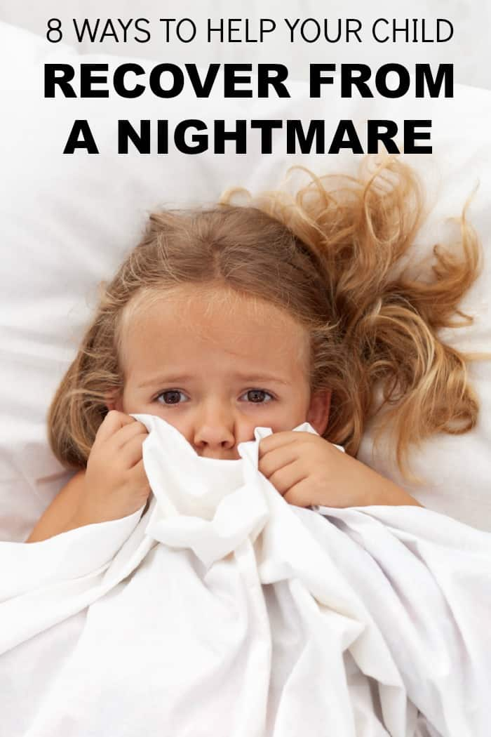 child in bed looking afraid