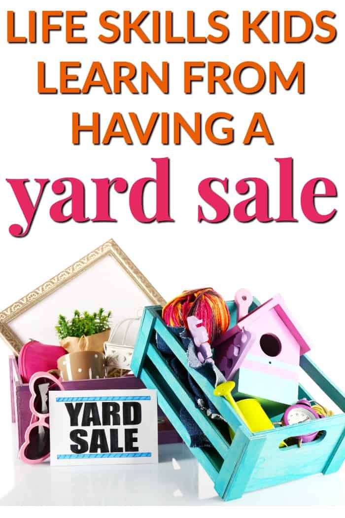 yard sale sign with household clutter