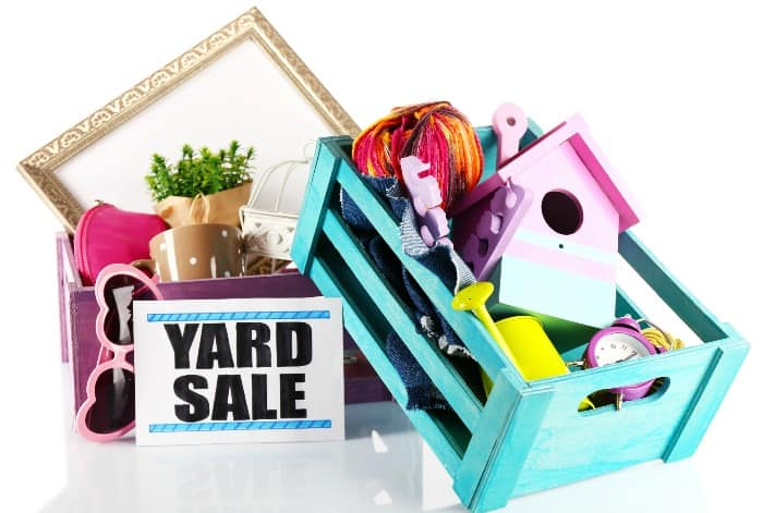 yard sale sign with clutter