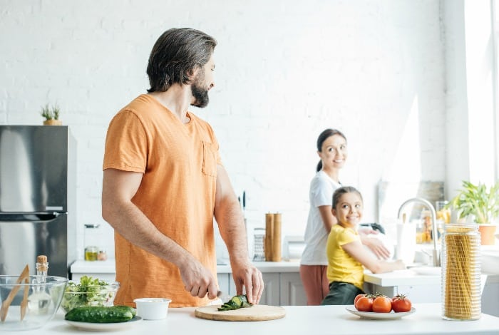 parents and child in the kitchen