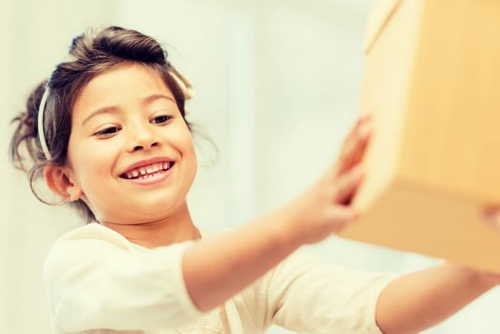 child smiling with box
