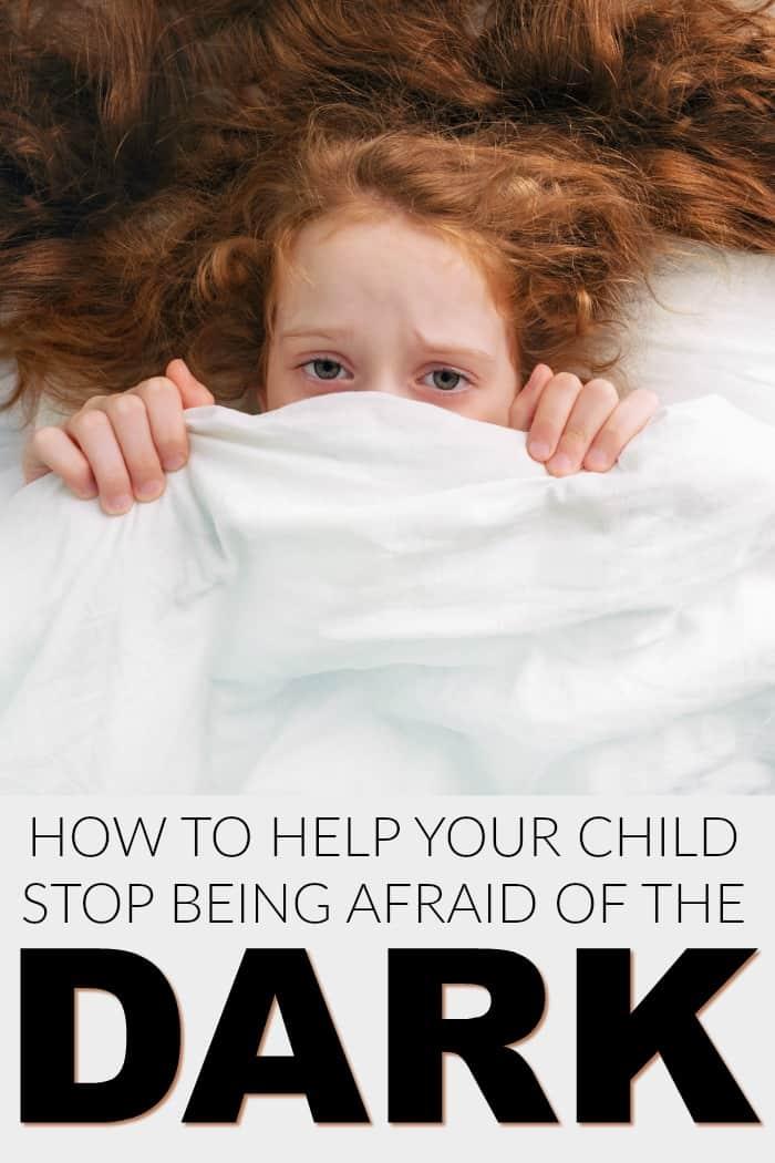 child under blanket afraid